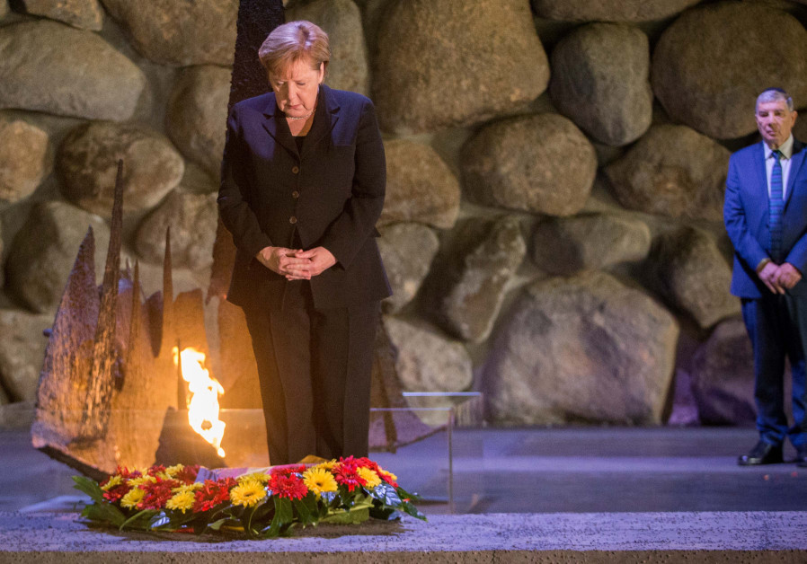 Angela Merkel lights the Eternal Flame and places a wreath at Yad Vashem, 2018.