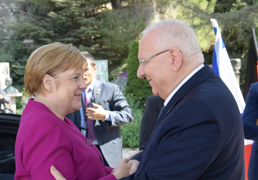German Chancelor Angela Merkel shaking hands with President Reuven Rivlin, October 4, 2018