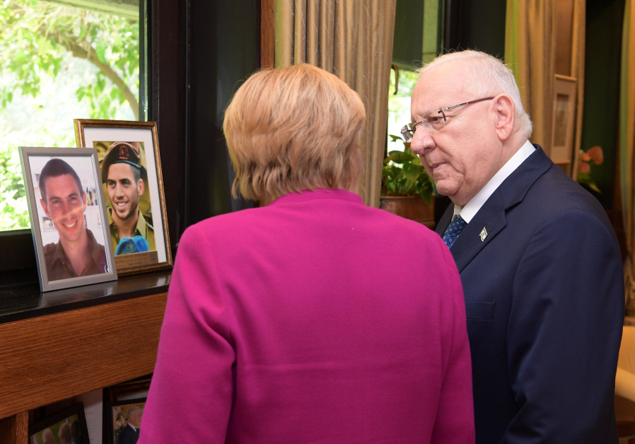 Photos of Lt. Hadar Goldin and St.-Sgt Oron Shaul, whose bodies are held by Hamas, viewed by German Chancelor Angela Merkel and President Reuven Rivlin, October 4, 2018