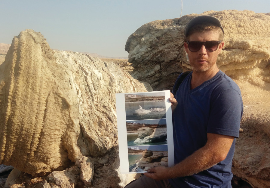 NOAM BEDEIN holds time-lapse images of the emergence of the magnificent salt structure