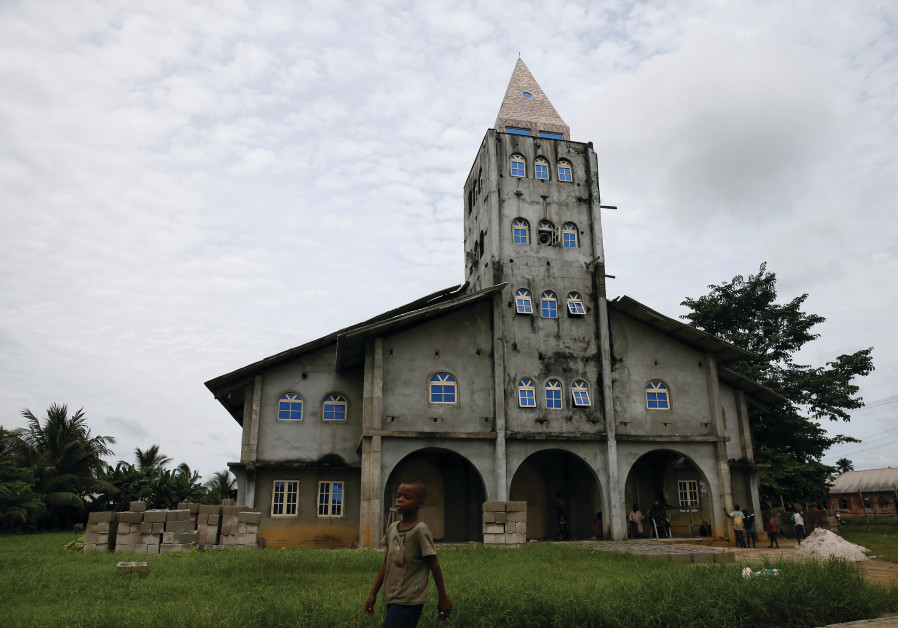 A BOY walk past the Apostolic church in Bodo, Nigeria