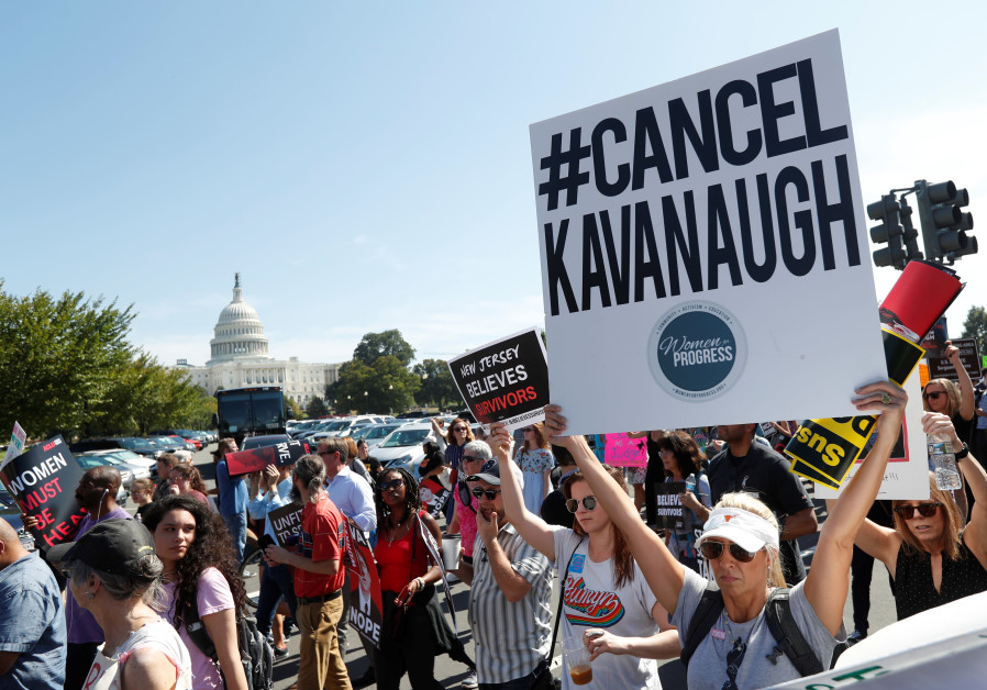 Activists hold a protest march and rally in opposition to U.S. Supreme Court nominee Brett Kavanaugh