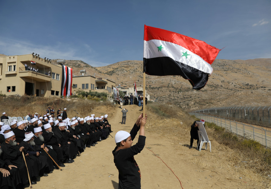 Golan Druze gather at border, chanting loyalty to Syria's Assad