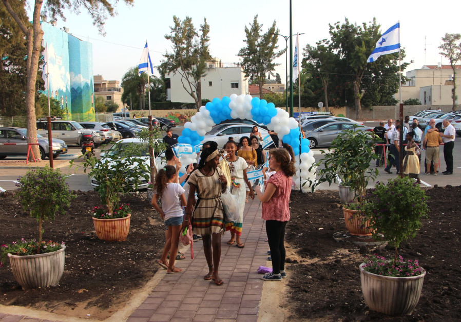 Welcoming visitors to the Friendship House community center in Kiryat Bialik