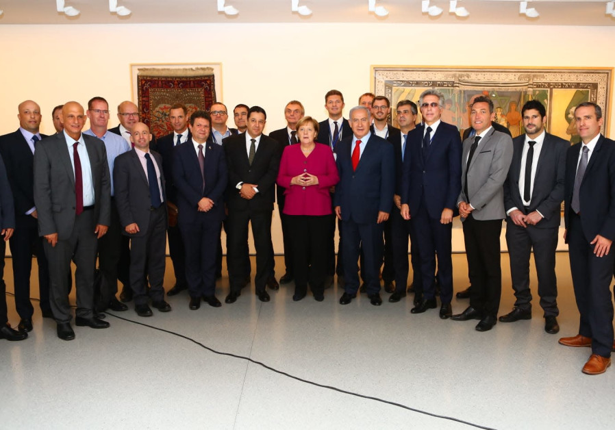 The 'embarrassing' photo of German Chancellor Angela Merkel at an all-male event