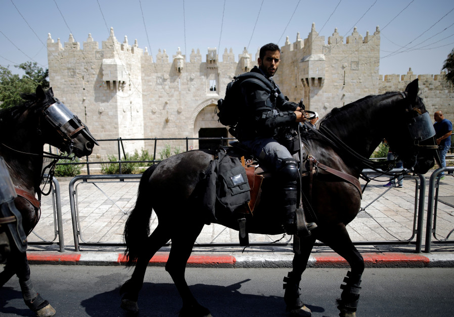 Israeli police ride their horses outside Damascus Gate at Jerusalem's Old city July 28, 2017.