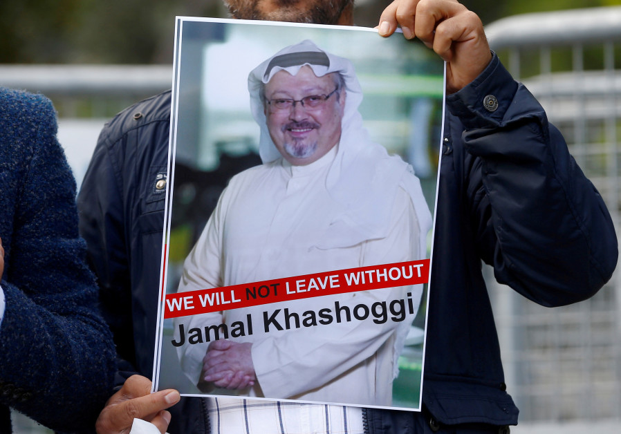 A demonstrator holds picture of Saudi journalist Jamal Khashoggi during a protest in front of Saudi