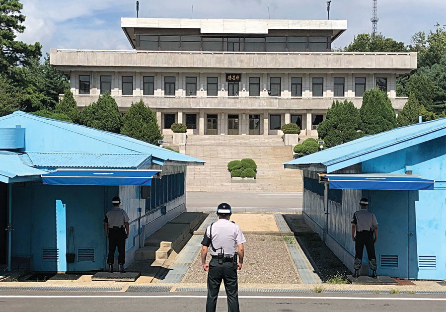 VIGILANT SOUTH Korean soldiers stand guard at the boundary with North Korea.