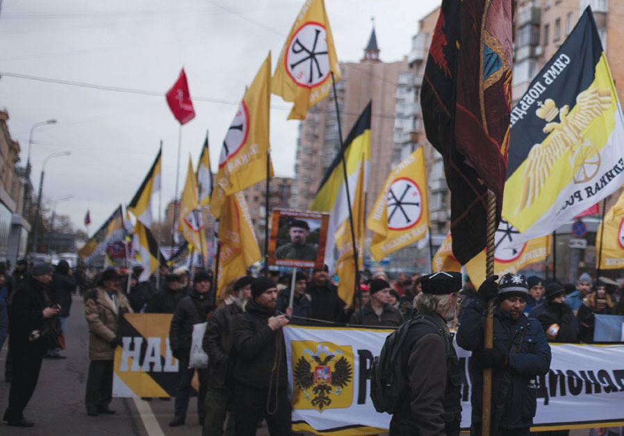MEMBERS OF a Russian nationalist group attend a march of the Unity of Nation in Moscow last year.