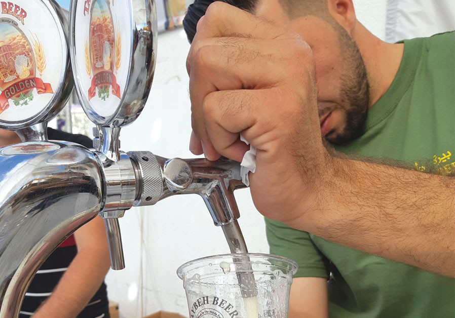 Brewer Canaan Khoury pouring at Oktoberfest