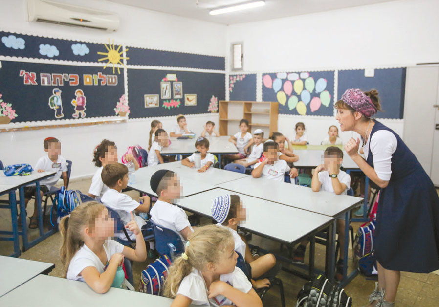First-grade pupils attend the first day of a school in Jerusalem on September 2
