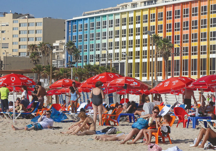 Israelis enjoy the sunshine on a Tel Aviv beach