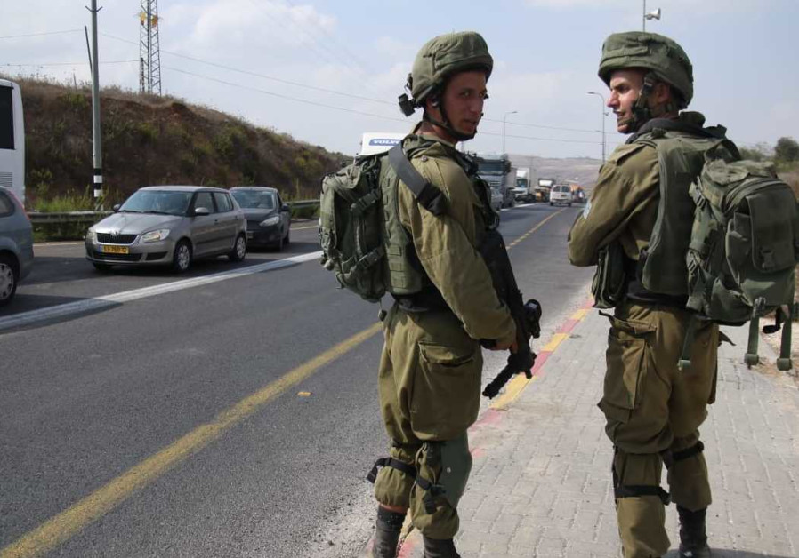 Soldiers at the scene of a stabbing attack in the West Bank on October 11, 2018.