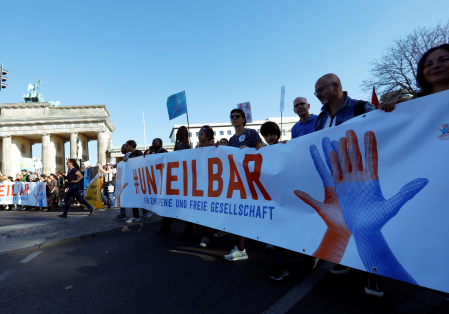 "Protesters gather to the ""#unteilbar"" demonstration which aims to ""rise up against discrimination"