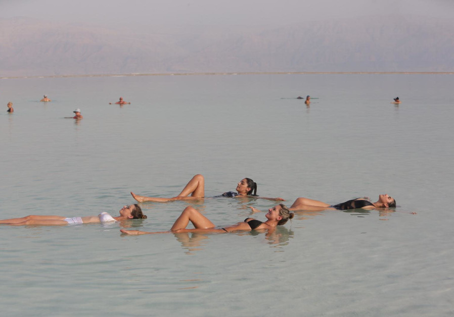 Colombian beauty queens floating in the Dead Sea on their visit to Israel