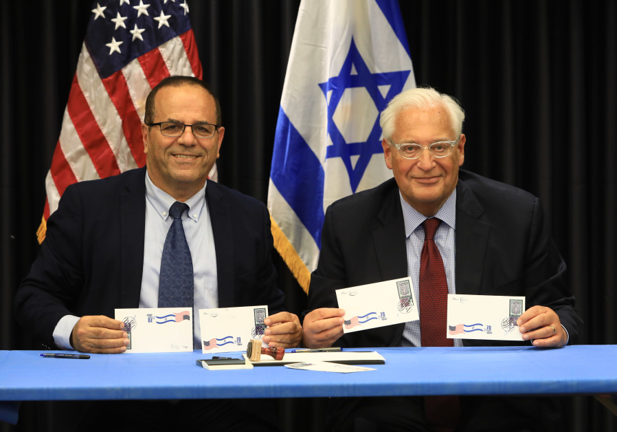 COMMUNICATIONS MINISTER Ayoub Kara (left) and US Ambassador David Friedman display first day covers