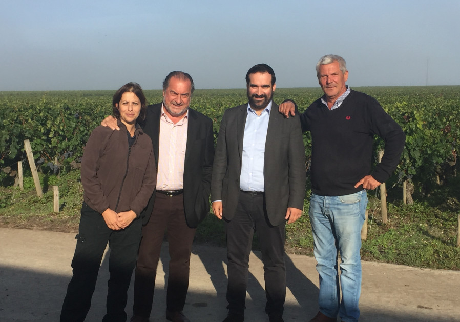 Menahem Israelievitch, winemaker of Royal Wine Europe, & wine consultant Michel Rolland, flanked by Dominique Bevre and Delphine Barboux, respectively general manager and cellar master of Chateau Lascombes.