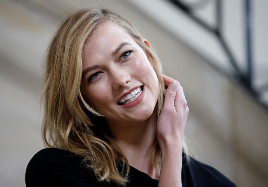 Model Karlie Kloss poses during a photocall before the French fashion house Christian Dior