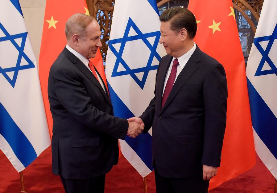 Chinese President Xi Jinping and Israeli Prime Minister Benjamin Netanyahu shake hands