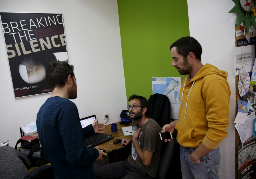 """Employees work at the offices of """"Breaking the Silence"""" in Tel Aviv, Israel, December 16, 2015"""