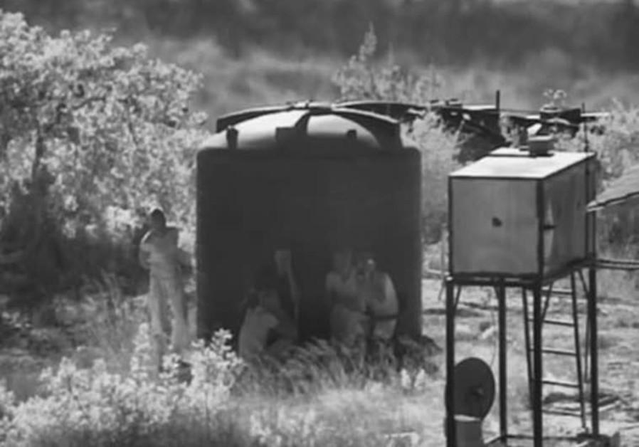 Hezbollah members near an outpost one kilometer from the Israeli border