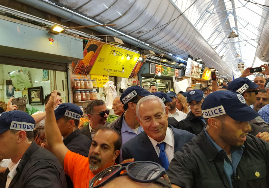 Prime Minister Benjamin Netanyahu visits the shuk in Jerusalem to campaign for municipal elections