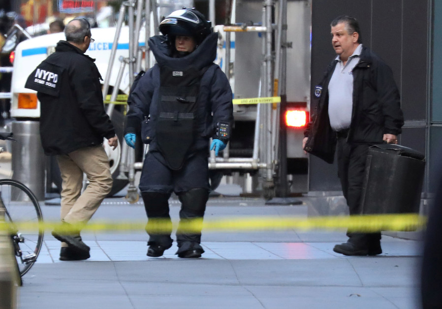 A member of the New York Police Department bomb squad is pictured outside the Time Warner Center in