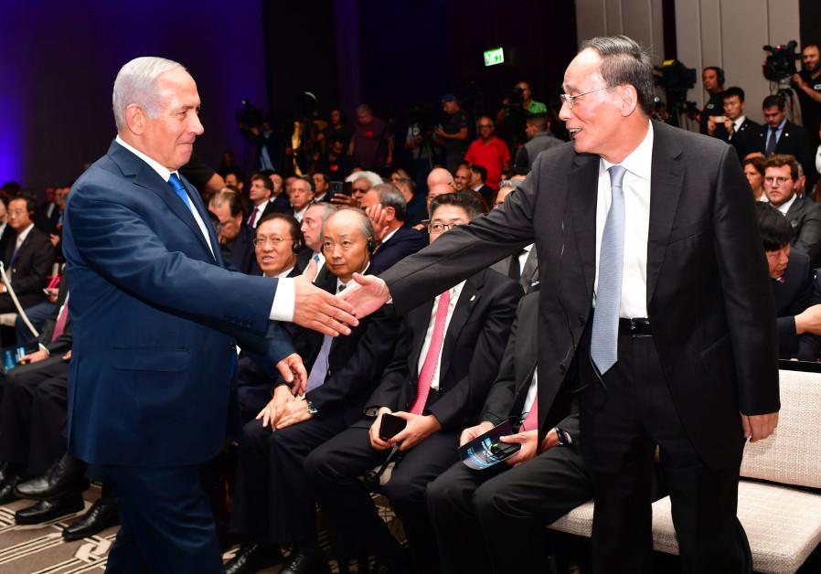 Prime Minister Benjamin Netanyahu greets Chinese VP Wang Qishan at the Innovation Conference in Jerusalem (GPO/KOBI GIDEON)
