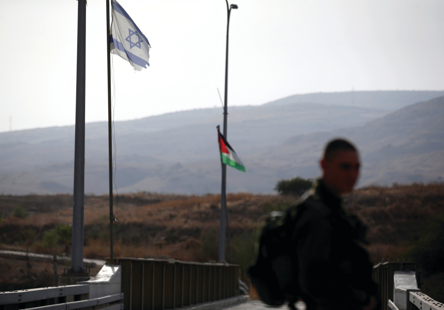AN IDF soldier patrols the border area between Israel and Jordan at Naharayim, as seen from the Isra