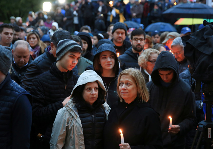 People mourn the loss of life as they hold a vigil for the victims of Pittsburgh synagogue shooting