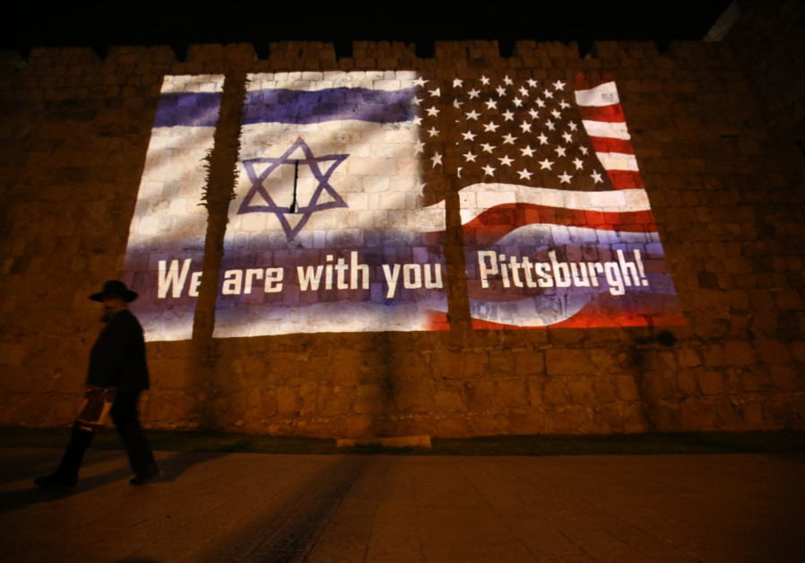 An Israeli and an American flag are projected onto Jerusalem's Old City walls near Jaffa Gate in sol