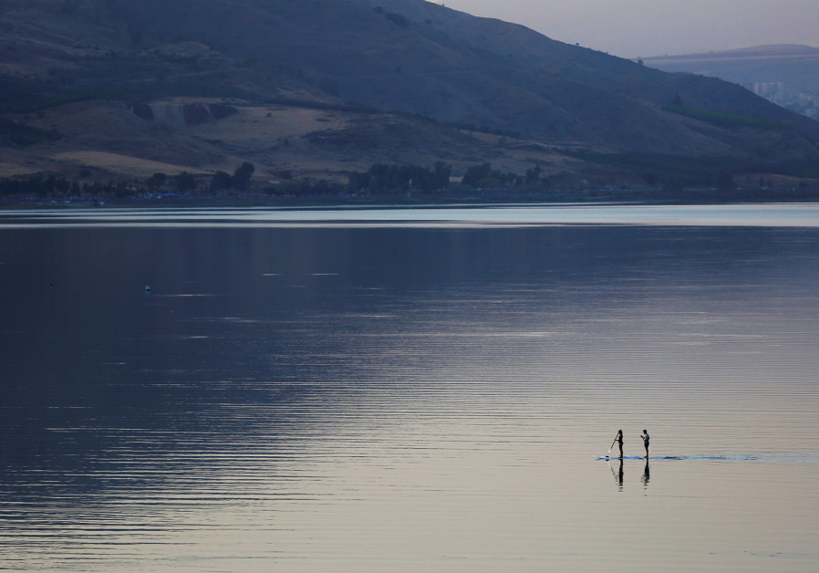 PEOPLE ON paddle boards float on Lake Kinneret in 2016. It is Israel's major surface fresh-water sou