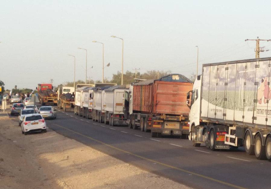 Activists block dozens of trucks from delivering supplies into Gaza.