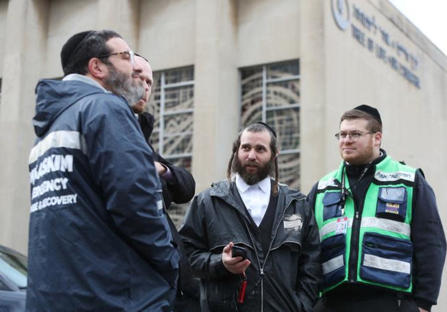 A crew from Chesed Shel Emes Emergency Services and Recovery Unit at the Tree of Life synagogue