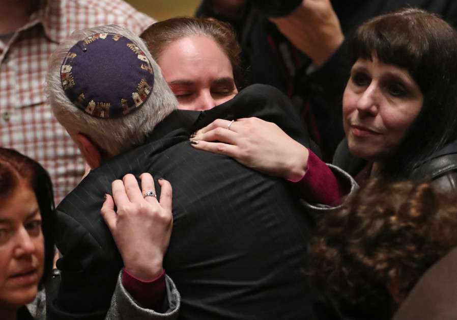 Mourners react during a memorial service at the Sailors and Soldiers Memorial Hall