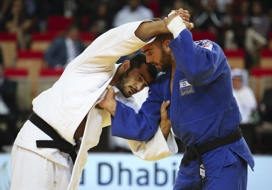 Peter Paltchik from Israel (blue) fights with against Gasimov Elmar (white) from Azerbaijan in the f