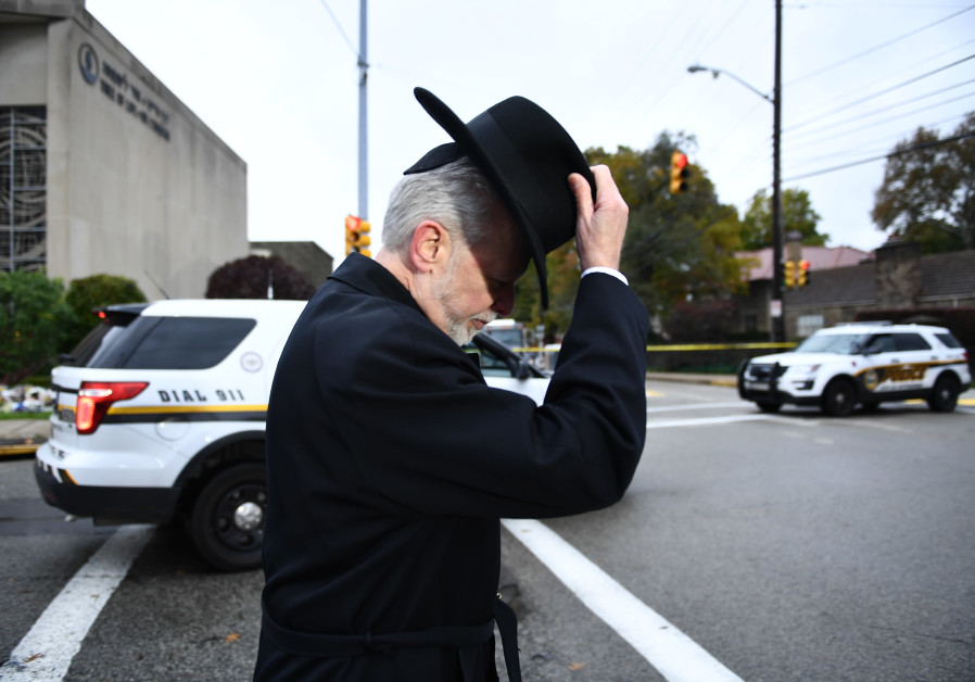 Rabbi Jeffrey Myers of the Tree of Life synagogue walks after speaking to reporters on October 29