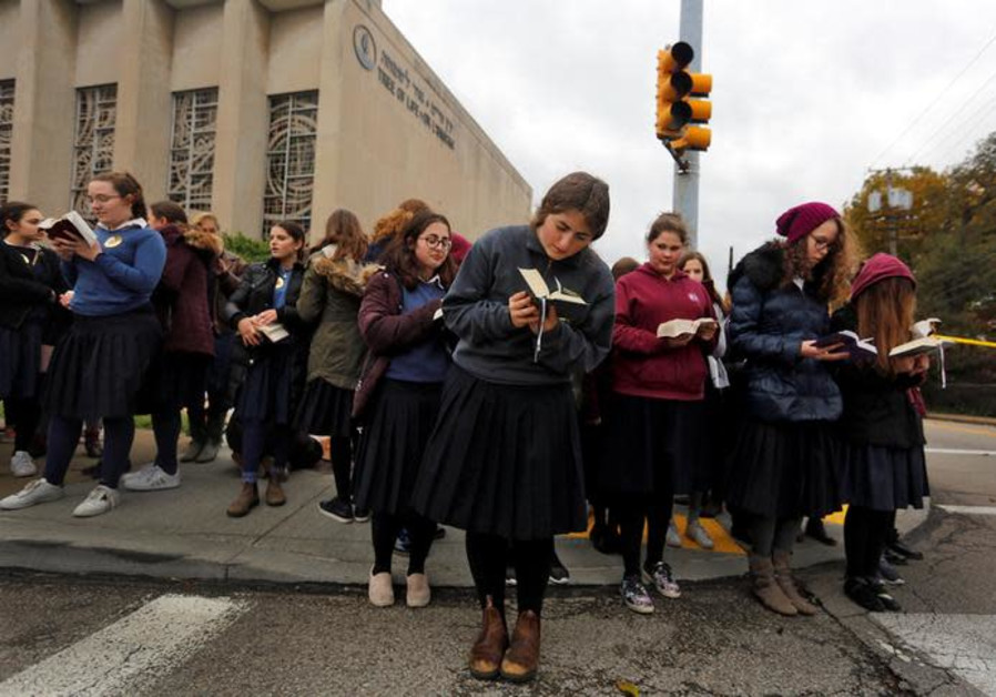 Pupils from the Yeshiva Girls School pray outside the Tree of Life synagogue