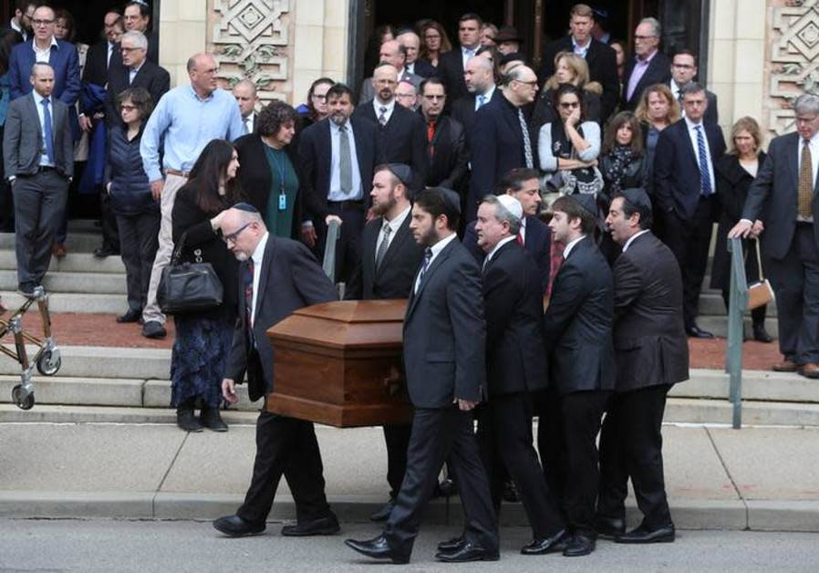 A casket is carried from Rodef Shalom Temple after funeral services