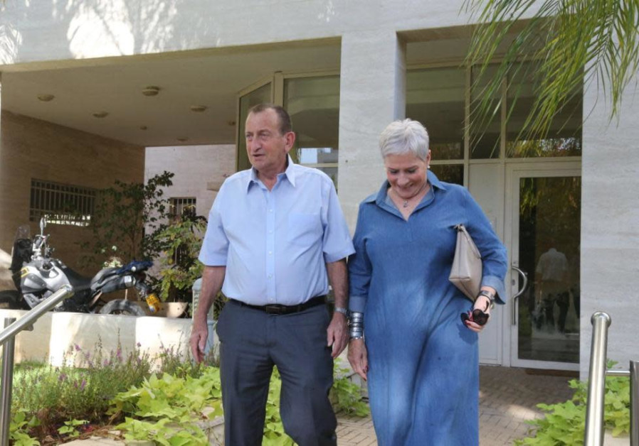 Ron Huldai and his wife the day after the election, leaving their house to the city hall, October 3