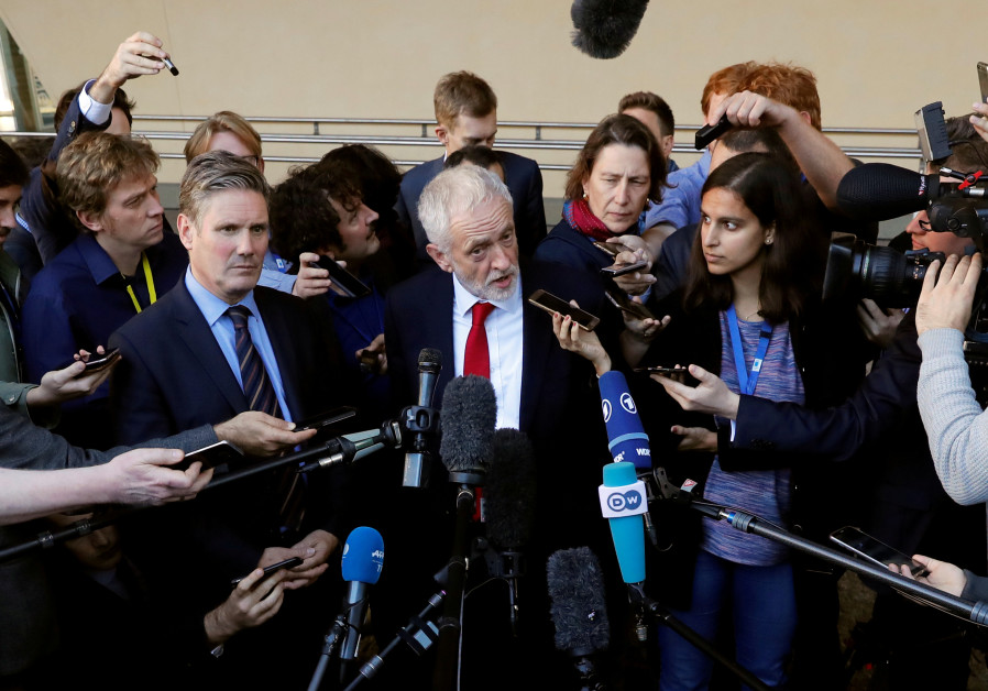 British Labour party opposition leader Jeremy Corbyn talks to reporters