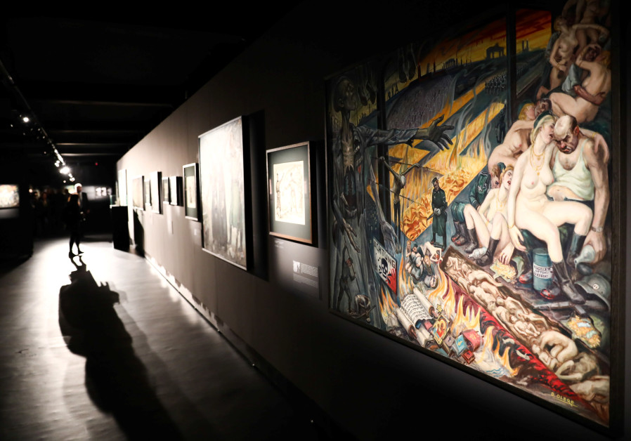 Paintings are pictured during the opening of an exhibition featuring works by David Olere.