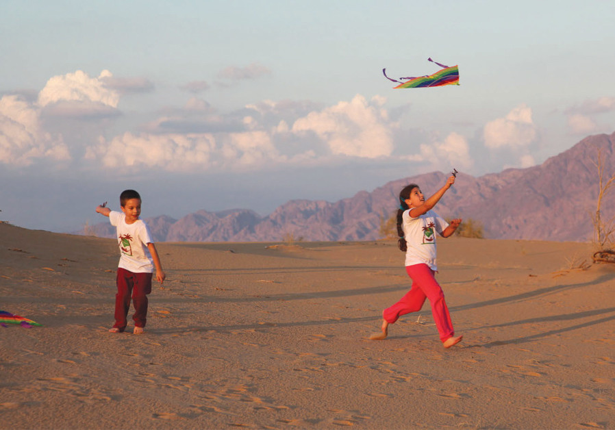 THURSDAY AFTERNOON is a great time to fly kites among the sand dunes. (photo credit: HAIM YAFIM)