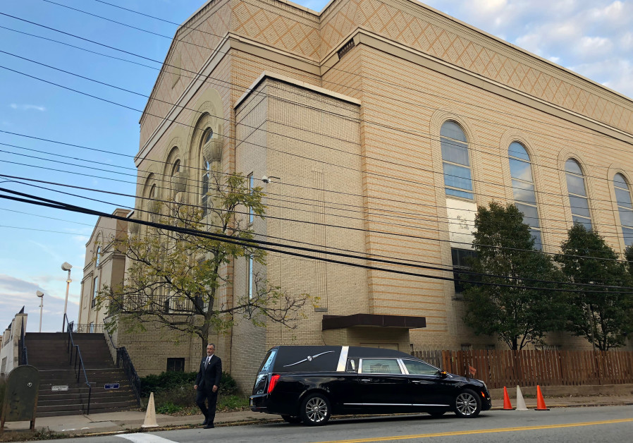 A hearse is parked outside the Beth Shalom Synagogue, where a funeral will be held for Joyce Feinber