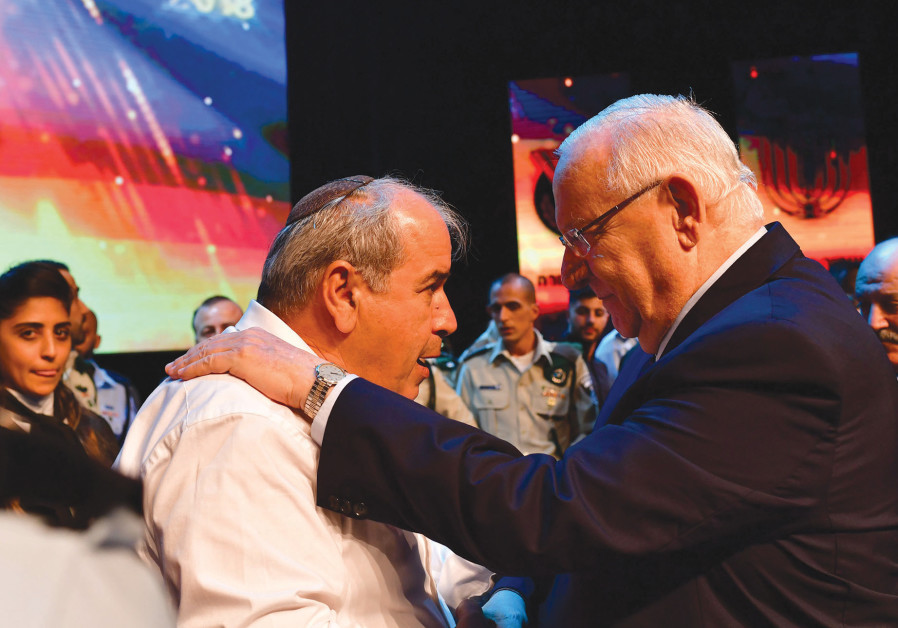 PRESIDENT REUVEN RIVLIN embraces David Malka, the father of the late Hadas Malka