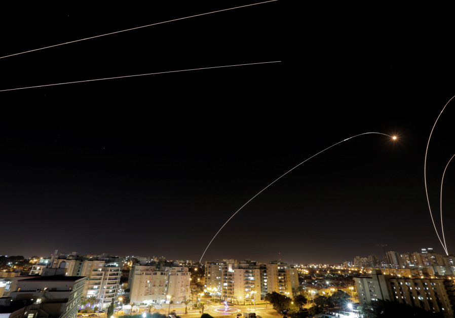 A general view of the Israeli city of Ashkelon, as an Iron Dome anti-missile fires near the Israeli