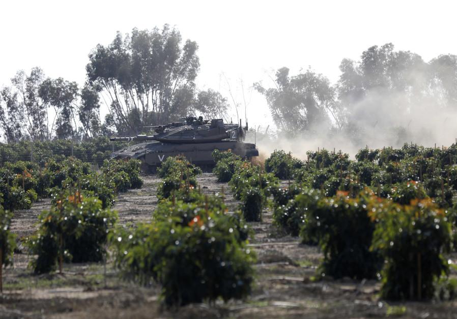 An IDF tank rolls along the Israeli border with the Gaza Strip on November 13 2018