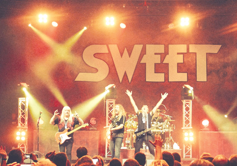 THE SWEET'S Andy Scott (left): I wouldn't want to be the band that goes on after us