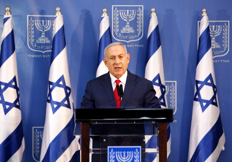 Prime Minister Benjamin Netanyahu delivers a statement to the members of the media in Tel Aviv