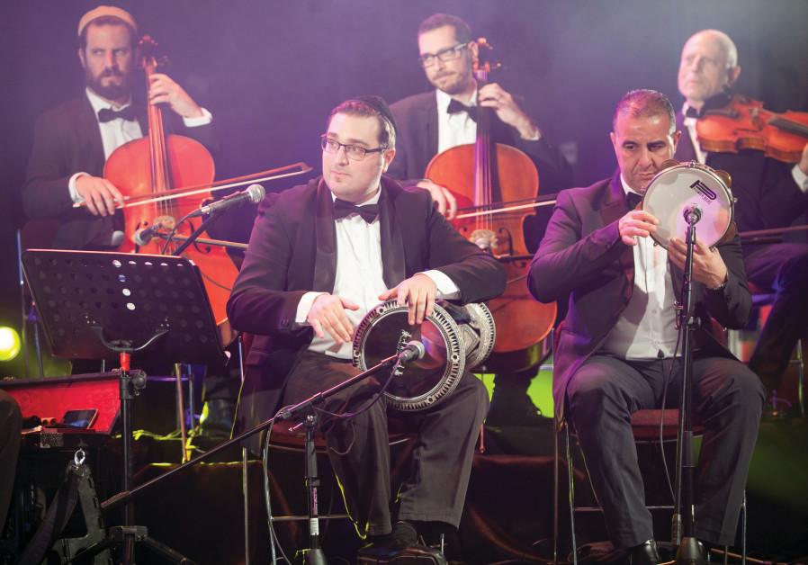 ARIEL COHEN, center, and the The Firkat al-Noor ensemble.